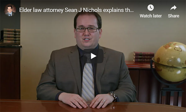 YouTube video overlay that plays a video of elder law attorney Sean J Nichols discussing what elder law is