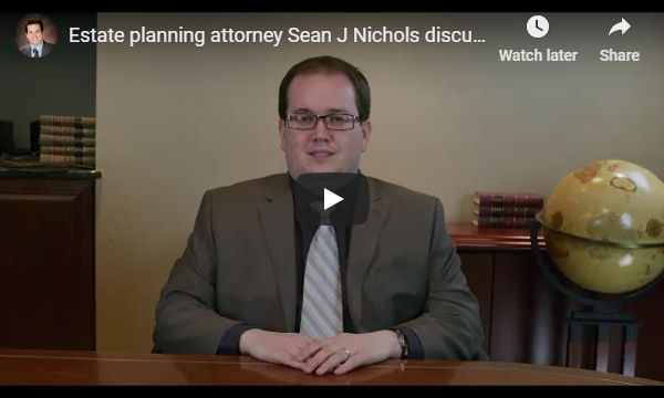 YouTube video overlay that plays a video of estate planning attorney Sean J Nichols discussing the aspects of estate planning in Michigan