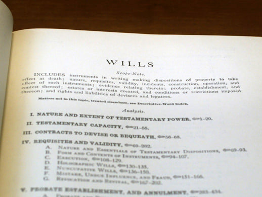 Open estate planning textbook on a table with the page titled wills