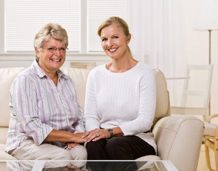 Mother and daughter on couch discussing hiring a Michigan probate lawyer