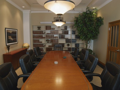 Conference room with a large wooden table surrounded by chairs inside the law offices of Sean J Nichols, PLLC
