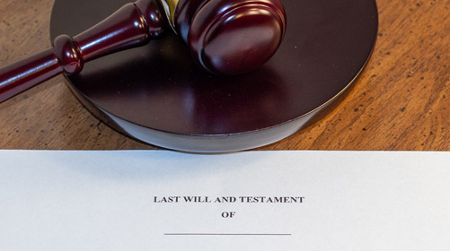Picture of an estate planning document called a Last Will And Testament next to a gavel